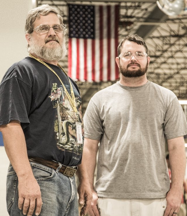 Makers in warehouse with American flag