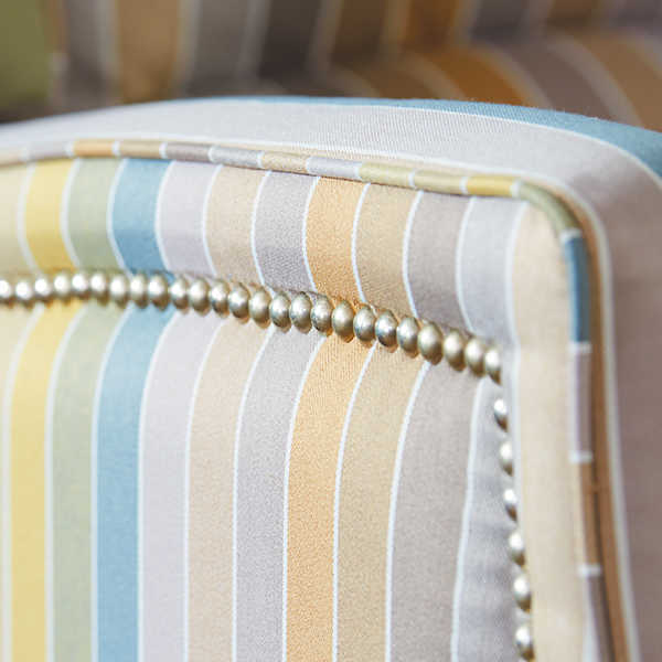 Closeup of platinum nailhead trim