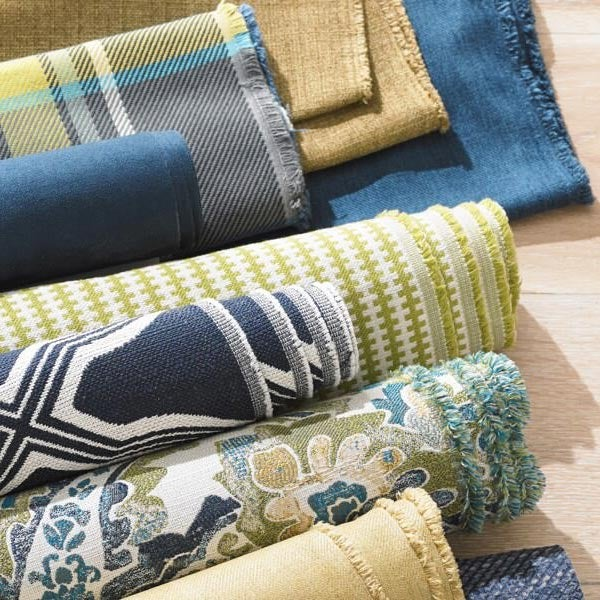 Rolls of fabrics in a variety of colors and patterns