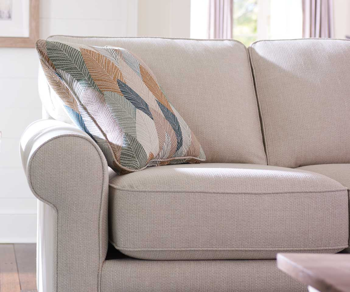 Closeup of Collins Sofa and custom pillow
