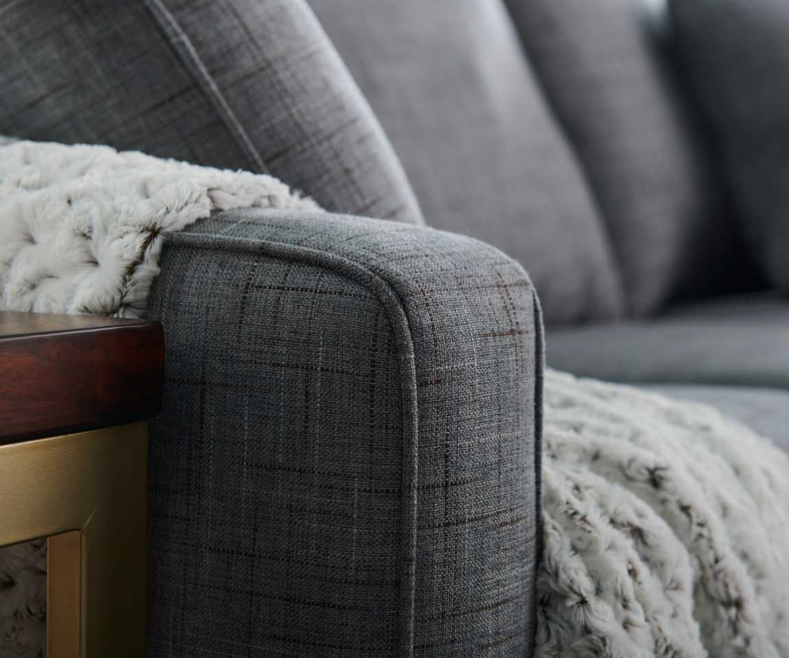 Closeup of Kennedy Sofa arm with blanket