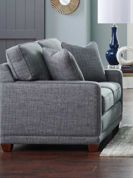 Living room with Kennedy Loveseat and accessories