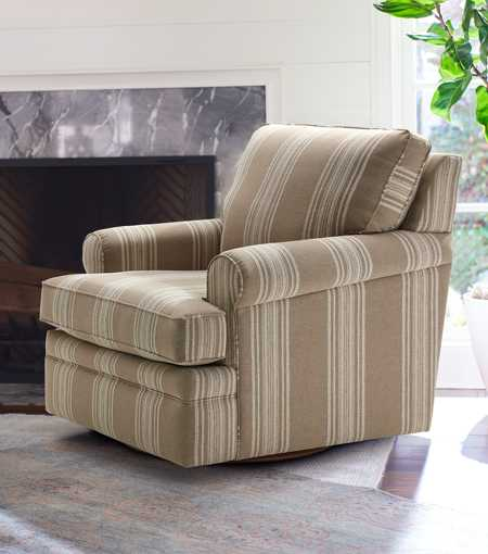 Roxie Swivel Gliding Chair by fireplace