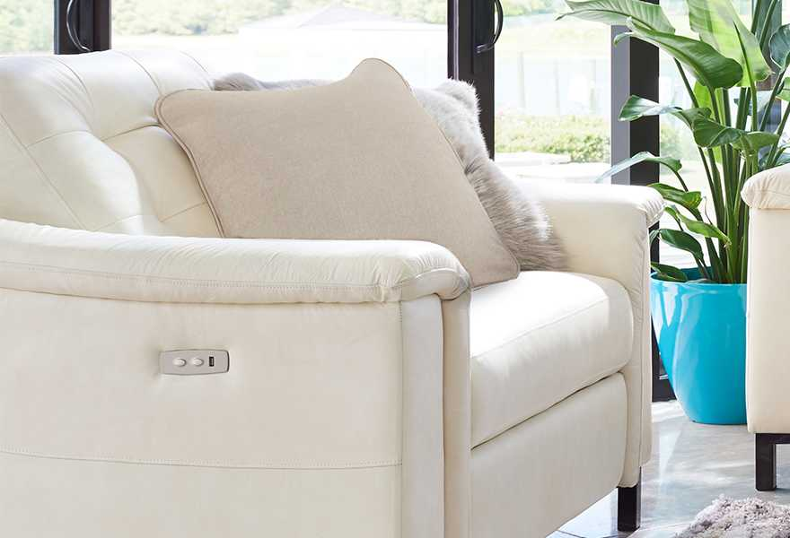Closeup of Luke duo® Reclining Sofa with custom pillows