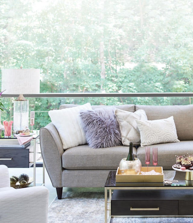 Living room with tribeca Sectional and Essence Rectangular Cocktail Table