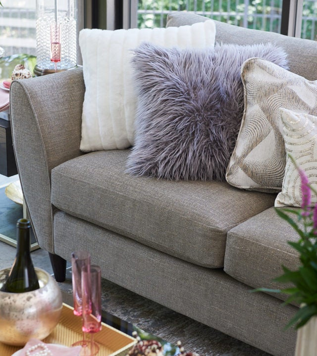 Closeup of tribeca Sectional with glam accessories
