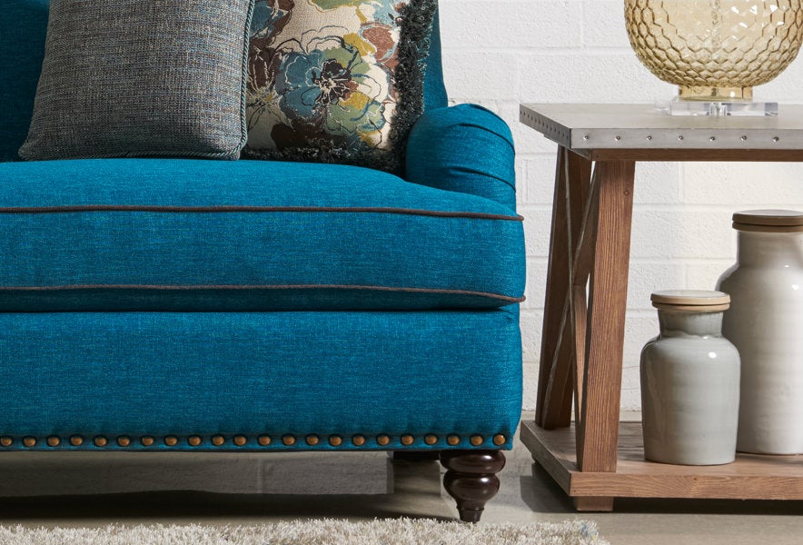 Room scene with Bexley Full Sleep Sofa and accessories