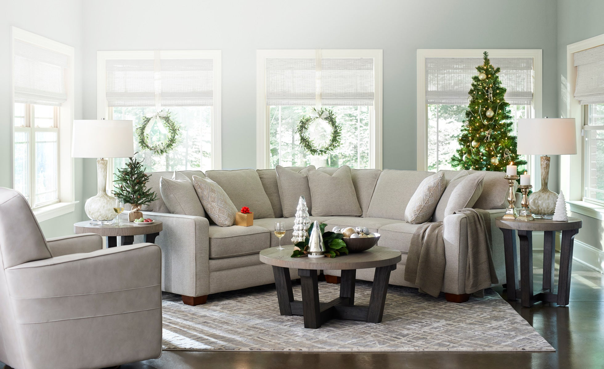 Home-Decor room scene with Midtown Swivel Glider, Meyer Sectional, Beckham Round Cocktail ...