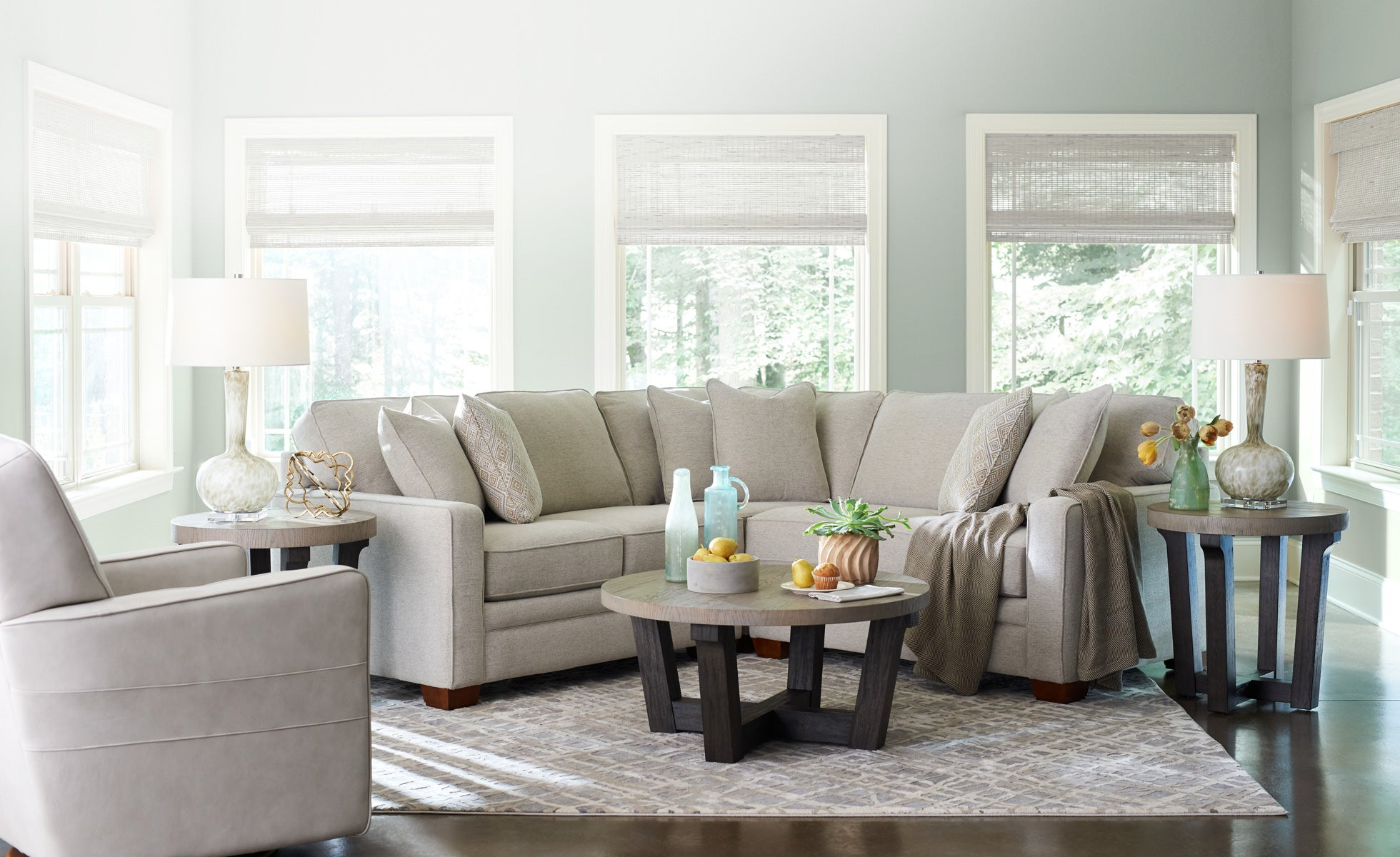 Home Decor Room Scene With Midtown Swivel Glider Meyer Sectional Beckham Round Cocktail