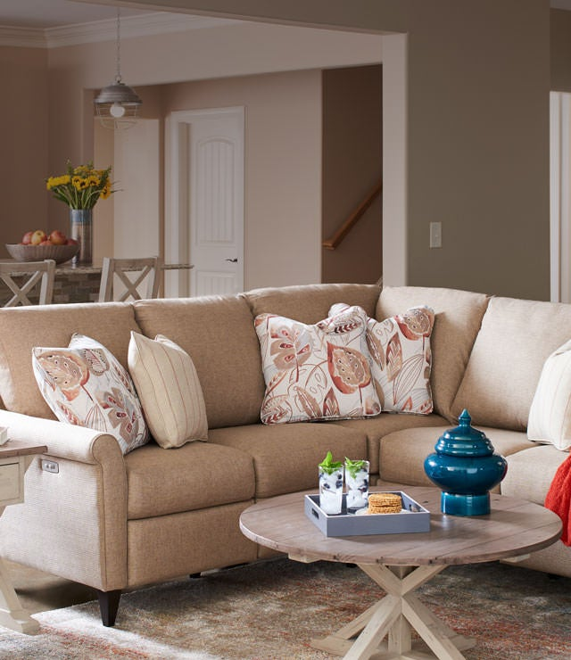 Home-Decor room scene with Abby duo Reclining Chair, Abby duo Reclining Sectional, Reclamation Place Cocktail Table and accessories