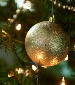 Room scene with metallic ornaments and evergreen branches