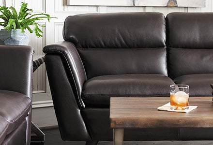 Closeup of leather sofa and ottoman