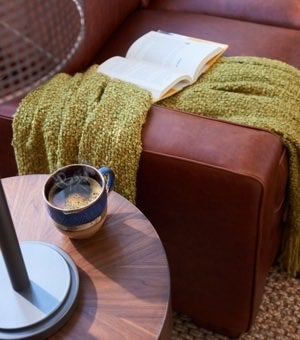 Closeup of Meyer Sofa arm and table with book and coffee