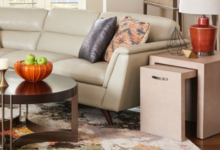 Arrow sectional with Kenton Round Cocktail Table, Vernon Nesting End Tables, and other accessories