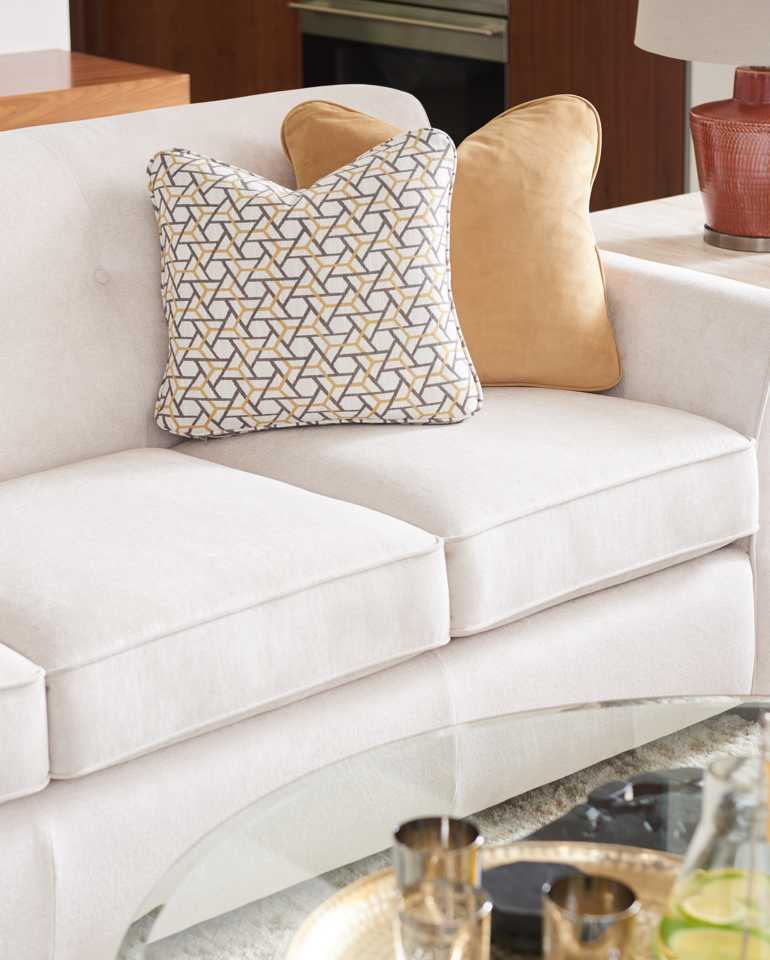 Closeup of Dixie Sofa with custom pillows and accesories