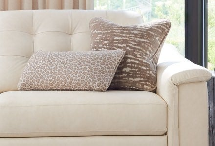 Closeup of Luke duo® Reclining 2-Seat Sofa with contrasting pillows