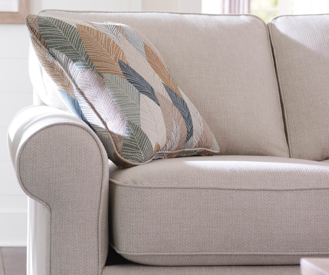 Closeup of Collins Sofa with contrasting pillow
