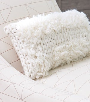 Closeup of Avenue Chair with contrasting pillow