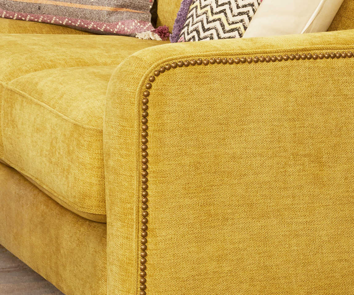 Closeup of Tribeca Sectional arm and Leo Ottomans