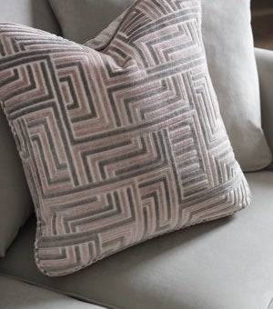 Closeup of pillows on Violet sofa