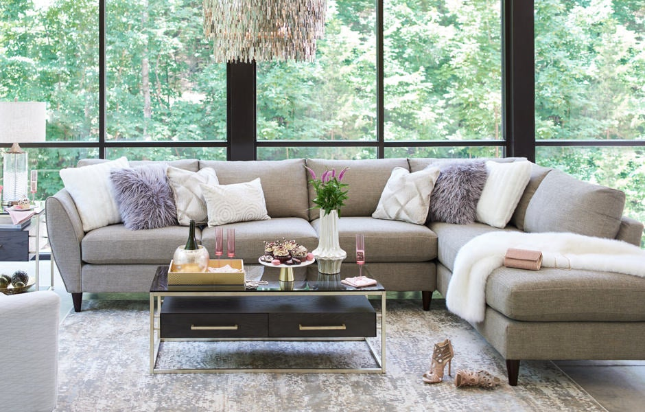 Living room with Tribeca sectional and Essence cocktail table