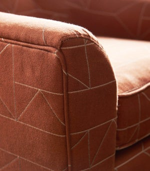 Closeup of Barista Chair with nutmeg brown cover