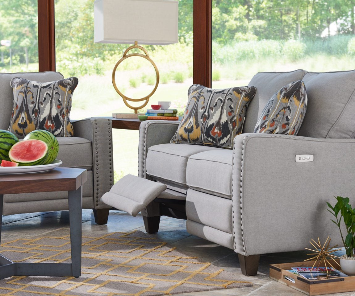 Room scene with Makenna duo® Reclining Loveseat and accessories