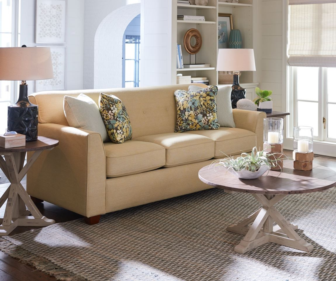 Summer room scene with Dixie Queen Sleep Sofa and accessories