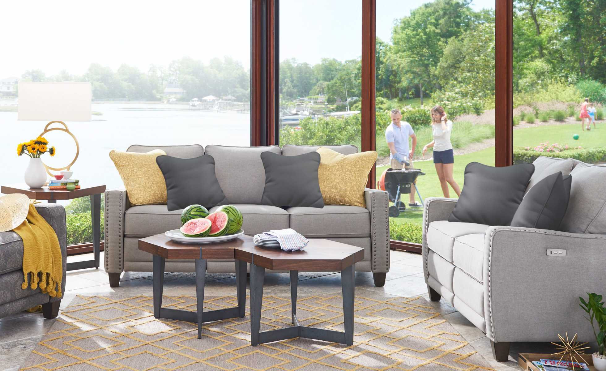Summer room scene with Makenna duo® Reclining Sofa and Loveseat and accessories