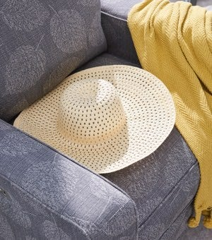Closeup of Makenna duo® Reclining Chair with hat