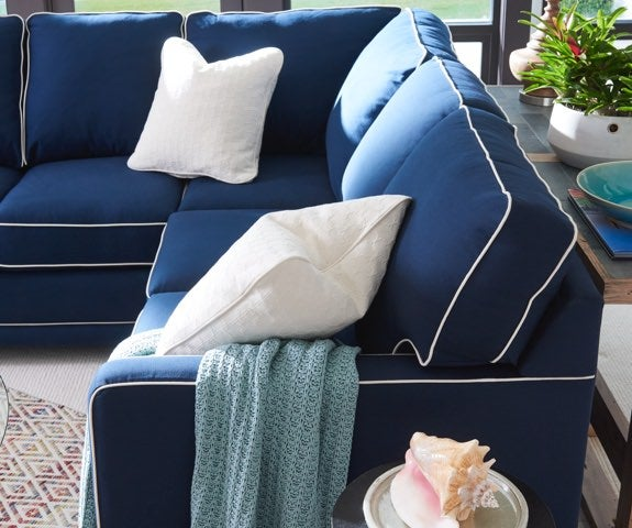 Closeup of Kennedy Stationary Sectional with blue cover and contrasting welt