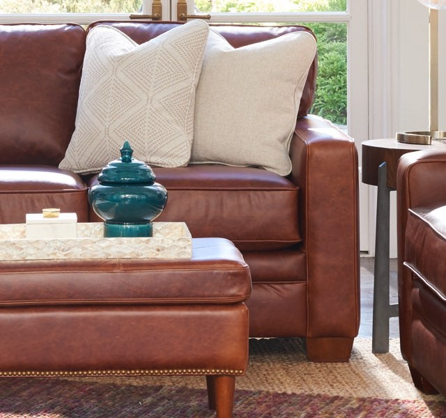 Room scene with Meyer Chair, Sofa, and Ottoman covered in leather
