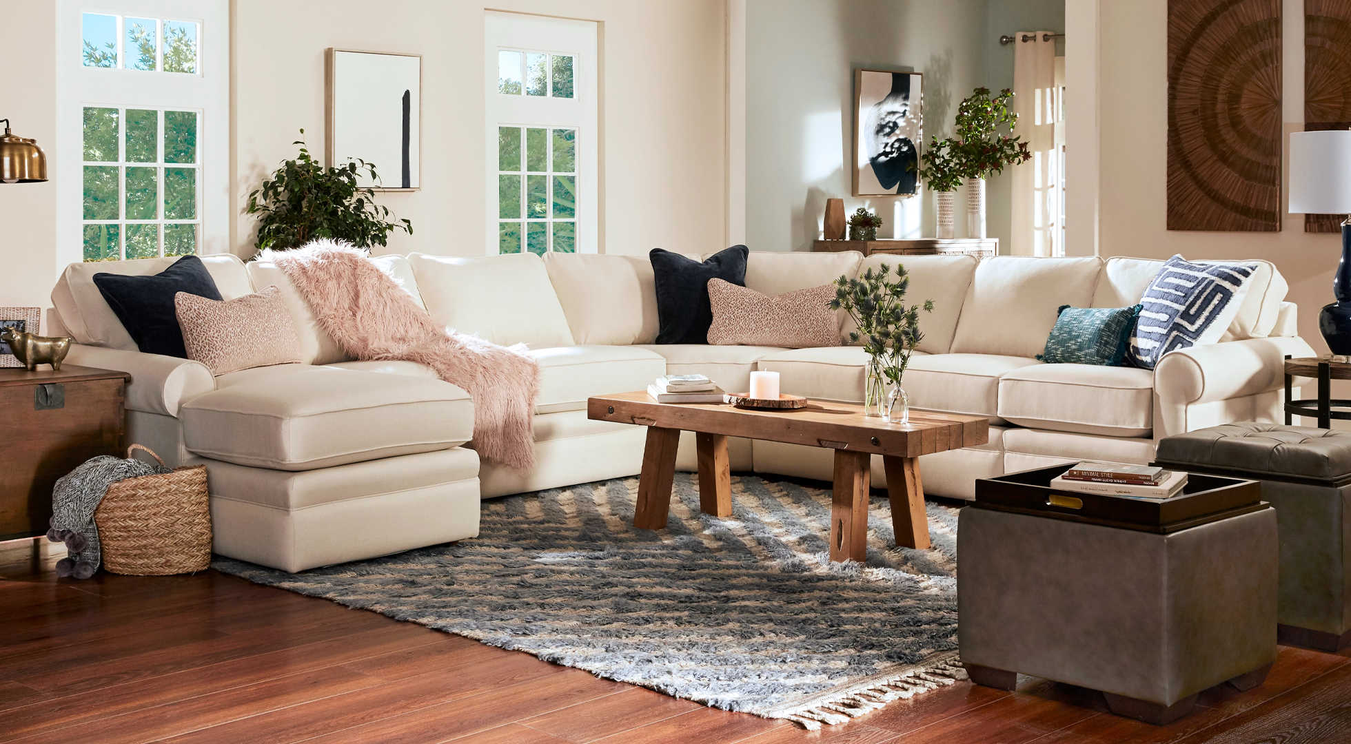 Living room with Ridgemont Sectional, Brentwood High Leg Reclining Chair, Isabella Table Lamp, and Logan Circle Ottoman