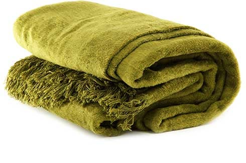 Folded green throw