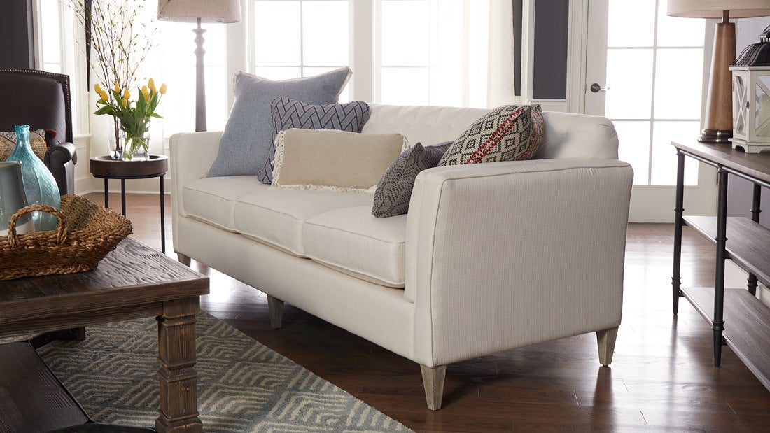 Editoral shot of Kirsten's sofa in her completed Design Dash room