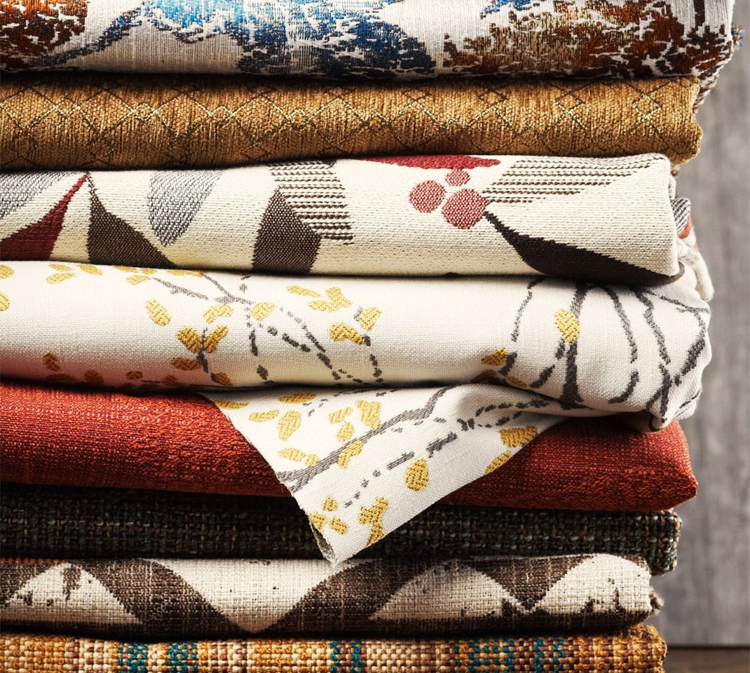 Closeup of stack of covers with various colors, patterns and textures