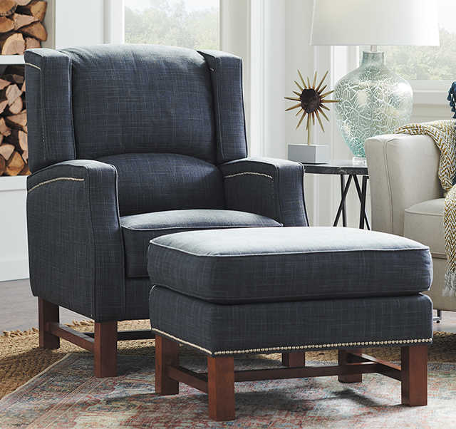 Living room scene with Thorne High Leg Reclining Chair and Phoebe Sofa in custom covers
