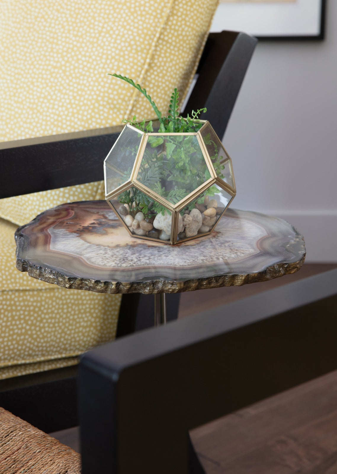 Living room scene with Hidden Treasures Brown Agate Table and plant