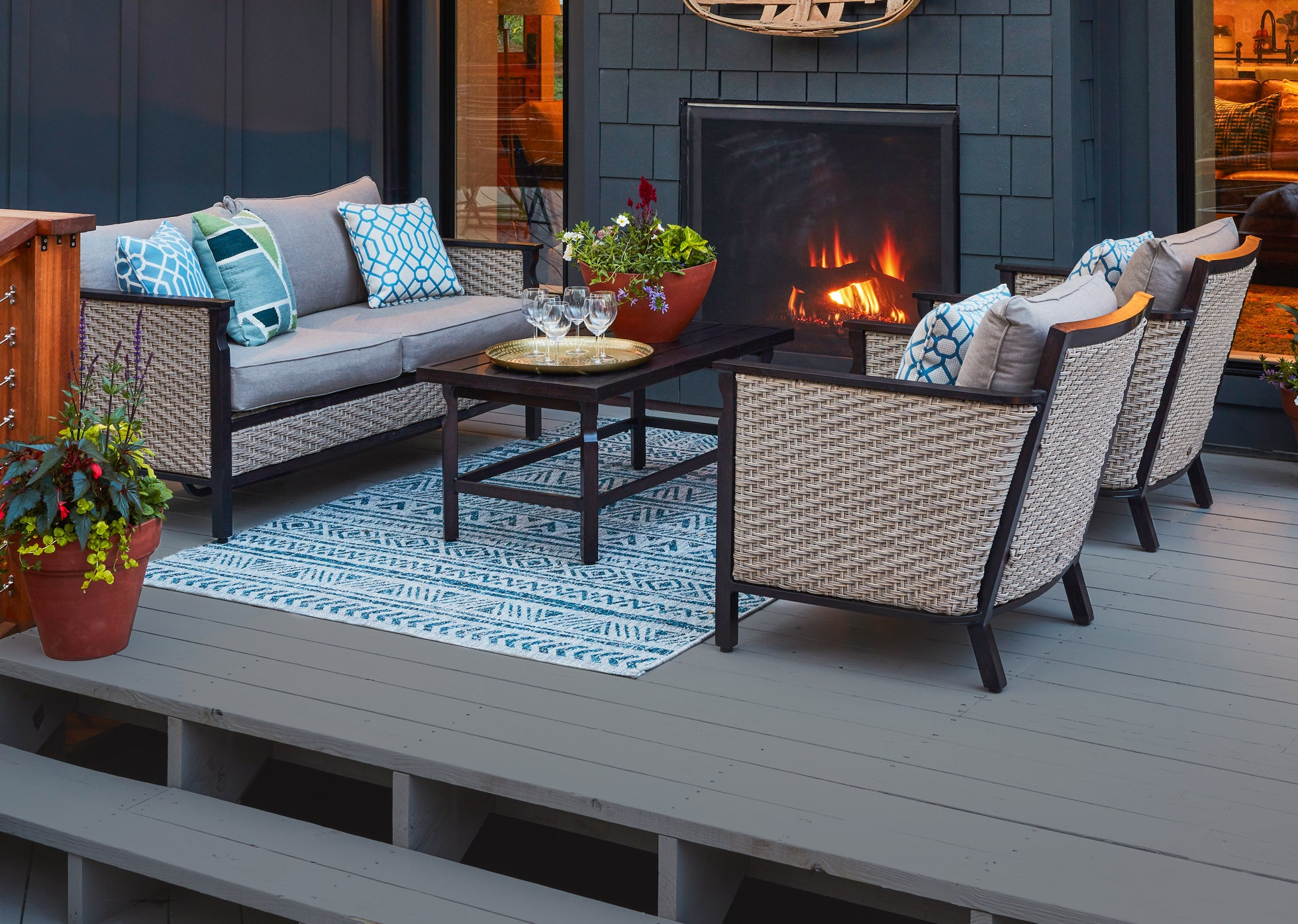Patio scene with Colton Loveseat, Coffee Table and Chair