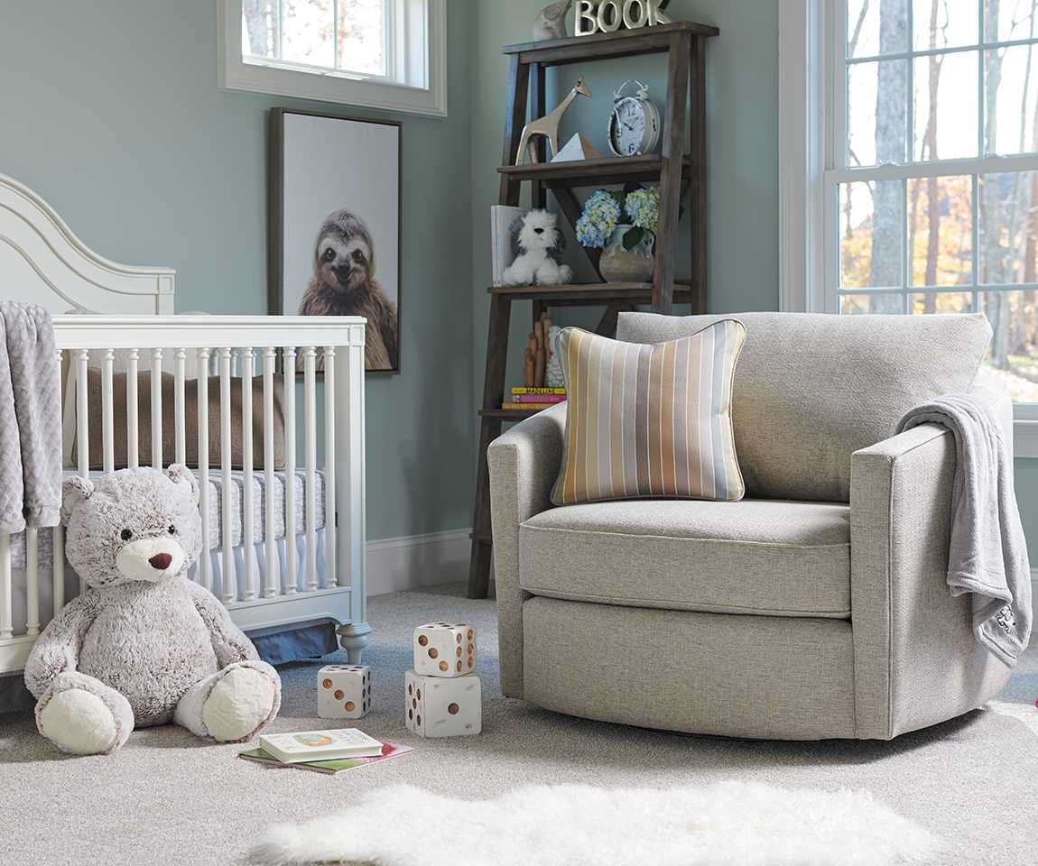 Clover Premier Swivel Occassional Chair in nursery with teddy bear