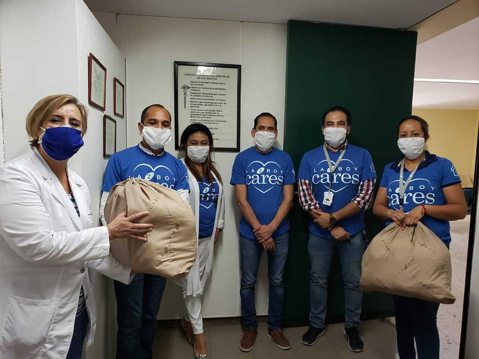La-Z-Boy team delivering masks to hospital worker