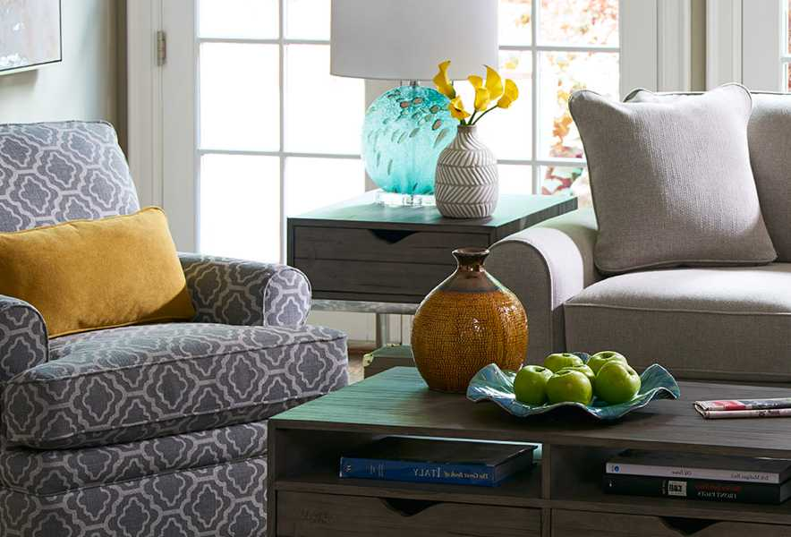 Room scene with Allegra Chair and Ottoman and accessories