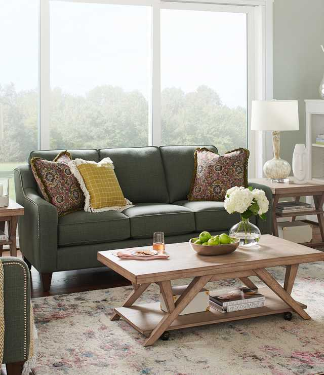 Comfortably casual living room with Talbot Sofa, Cambridge Reclining Chair, Exposition Rectangular Cocktail Table and accessories