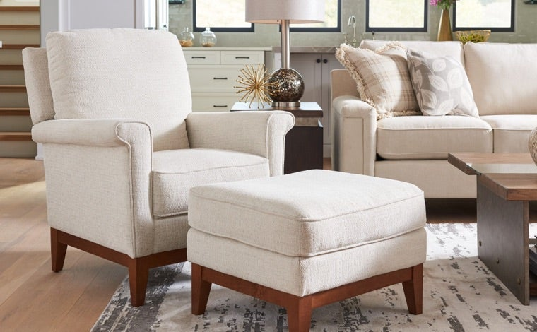 Living room with Ferndale Press Back Reclining Chair and Ottoman and Bexley Sofa