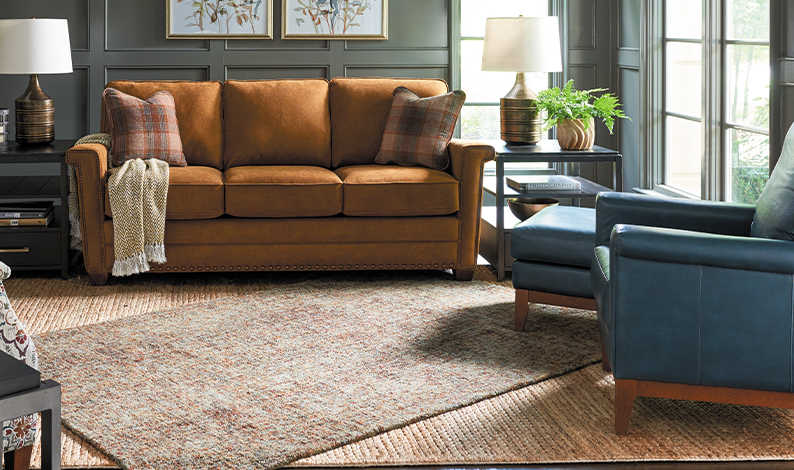 Living room with McKinney Sofa, Bellevue High Leg Swivel Chair, and Logan Square Ottomans