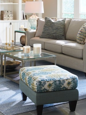Room scene with Gatsby Chair and Ottoman, area rugs and accessories