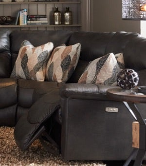 Room scene with James Power Reclining Sofa, Junction Compass End Table and accessories