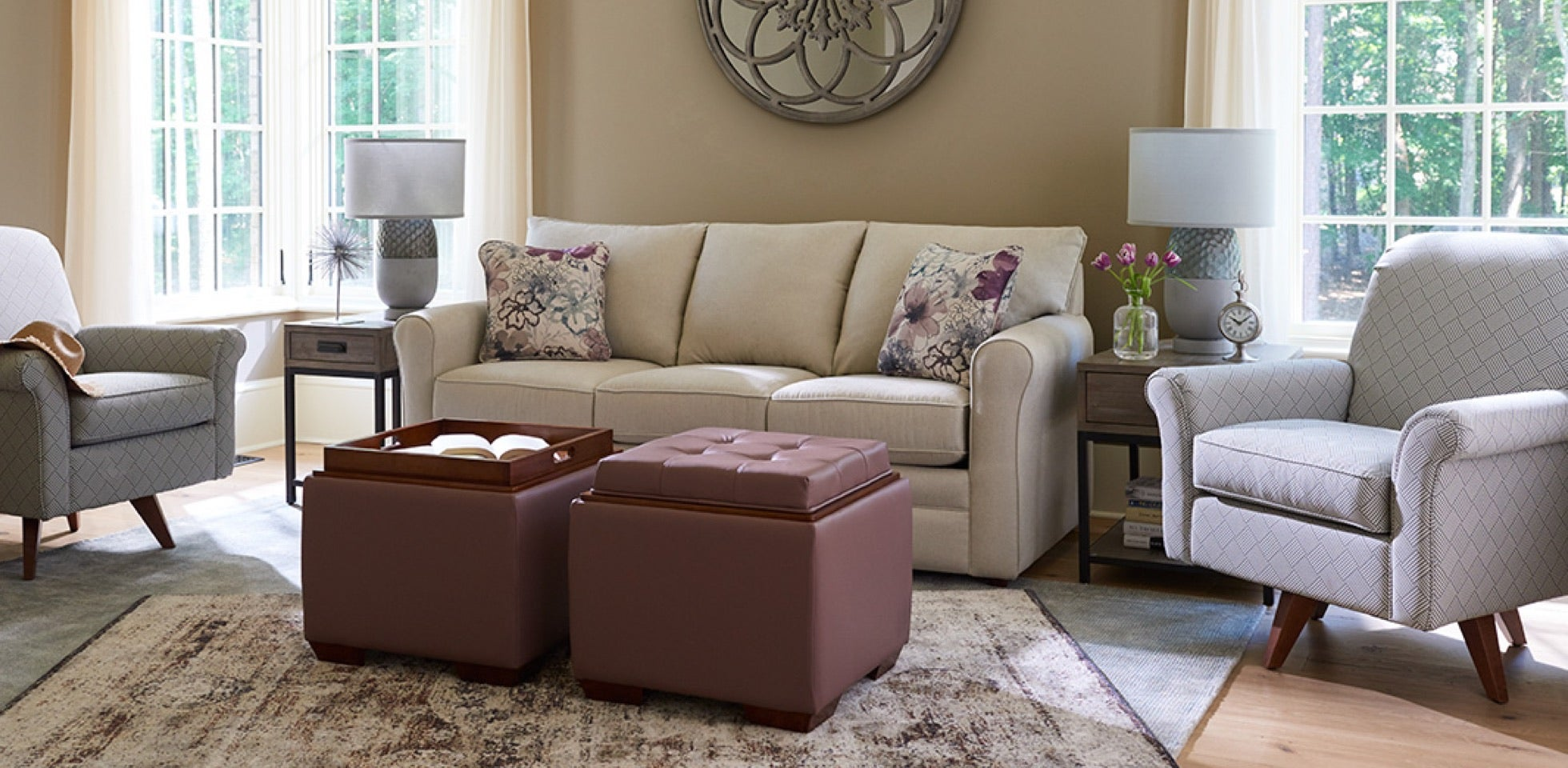 Family Favorite  room scene with Leah Queen Sleep Sofa, Leo Ottoman, Ronnie High Leg Swivel Recliner with area rugs and accessories