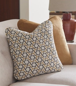 Closeup of Dixie Sofa, contrasting pillows and accessories